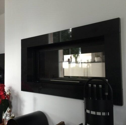 cheminée design foyer fermé vision traversante realisation Cheminées iiio
